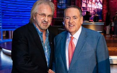 THE OAK RIDGE BOYS' DUANE ALLEN PRESENTS LIBERTY LEGENDS USA SUIT TO GOV. HUCKABEE DURING LATEST AIRING OF HUCKABEE
