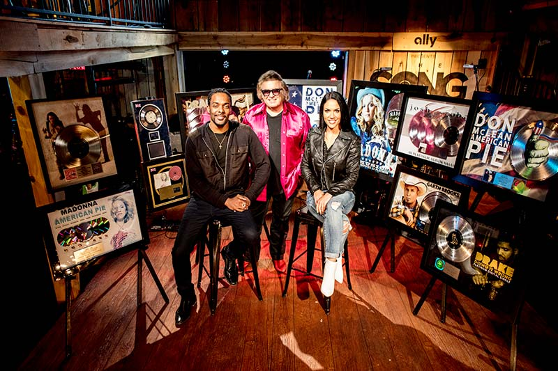 Damien Horne, Don McLean and Krista Marie on the set of The Song surrounded with multiple Platinum and Gold awards from Madonna, Drake, Josh Groban, and Garth Brooks.