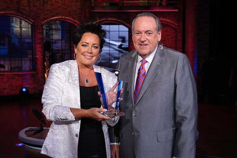Kelly Lang and Gov. Mike Huckabee