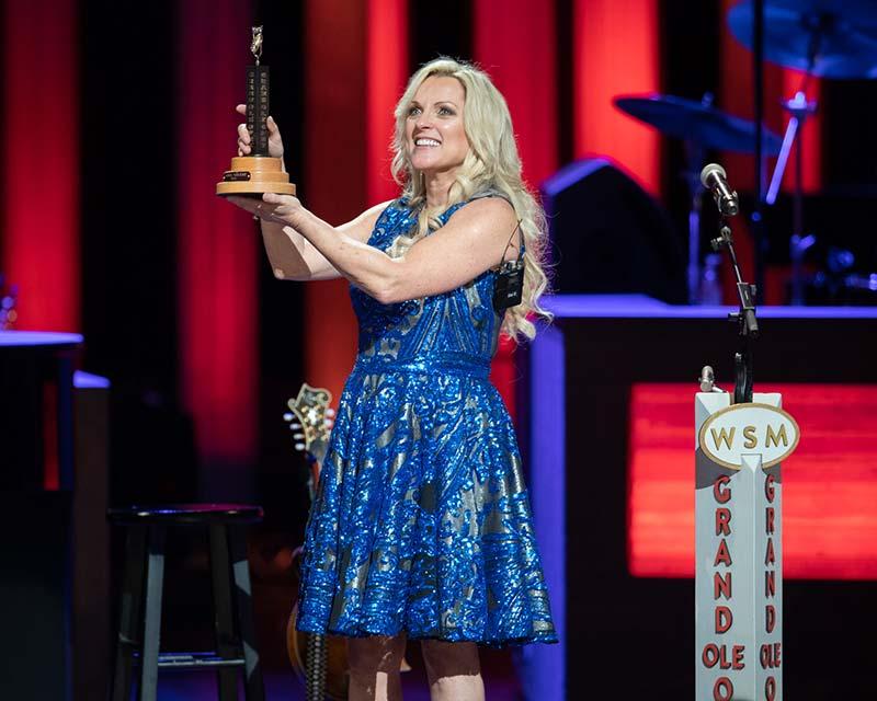 Rhonda Vincent with Opry member award