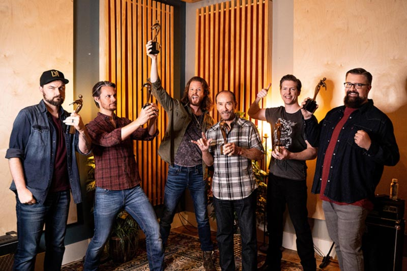 Lee Greenwood and Home Free pose with Telly Awards